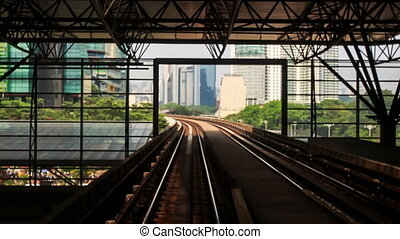 Camera moves along KL Metro Rails among Skyscrapers