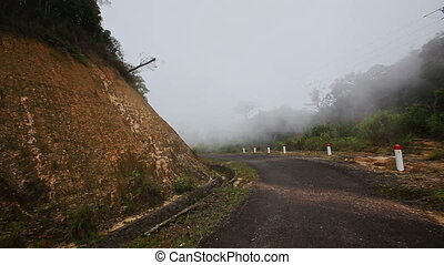 Camera Moves along Misty Mountain Asphalt Road