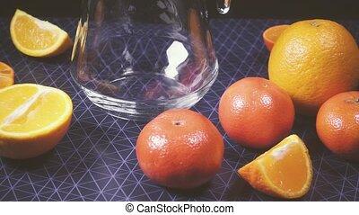 Camera moves along the citrus fruit slow motion - Camera...