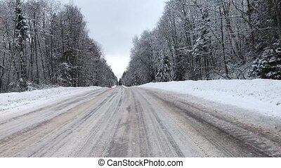 Camera moves and takes winter road car in the daytime. Video...