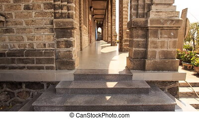 Camera Moves between Wall and Colonnade of Catholic Church -...