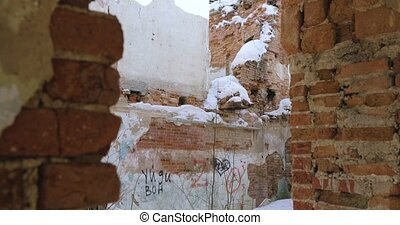 camera moves from the bottom up and removes the destroyed building of red bricks