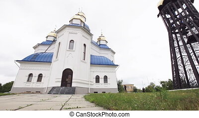 Camera moves past the white blue Orthodox Church. Full HD