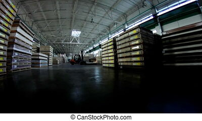 Camera moving at warehouse in lumber factory