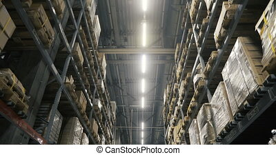 Camera moving between palettes with ordered goods and...