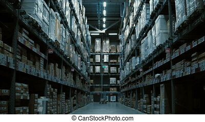 Camera moving between pallets, shelves with some goods and...