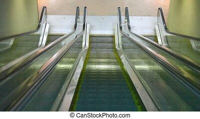 camera moving down on escalator