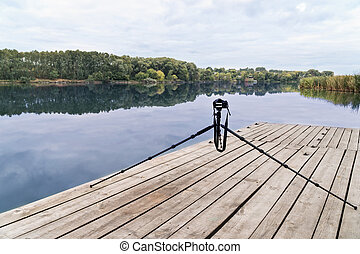 Camera on a tripod at the river