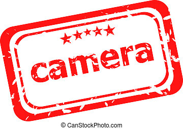 camera on red rubber stamp over a white background