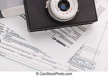 Camera on tax form background