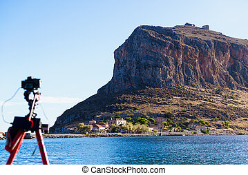 Camera on tripod and Monemvasia island - Professional camera...
