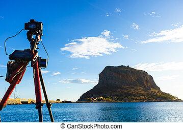 Camera on tripod and Monemvasia island