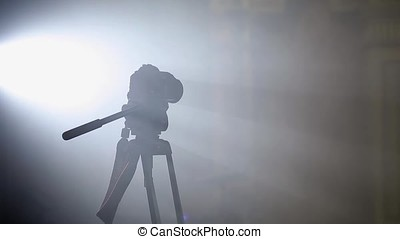 Camera on tripod in light