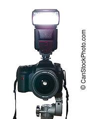 Camera on tripod with flash firing