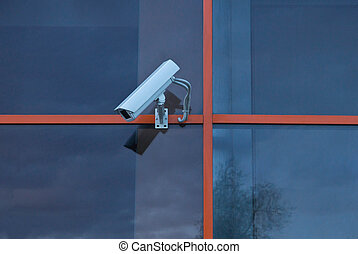camera on wall of a building