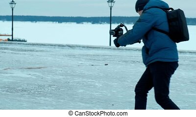 Camera operator Walk with electronic stabilizer in winter 4