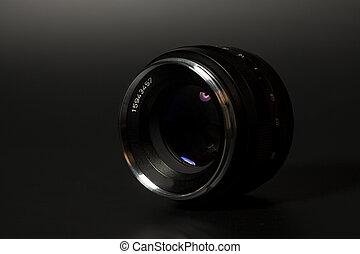 Camera photo lens over black background