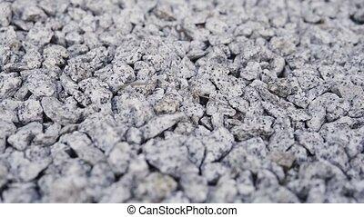 Camera slide over granite gravel - Camera slide over close ...