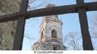 camera takes the ruined church and moves back behind the...