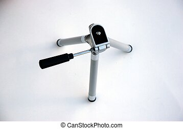 Camera Tripod - silver camera tripod on white background
