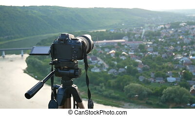 Camera tripod view sun - Camera on the tripod at the amazing...