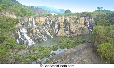 camera turns around Pongour waterfall among central highland...