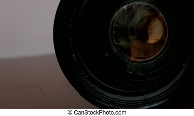 camera with its lens zooming in and out