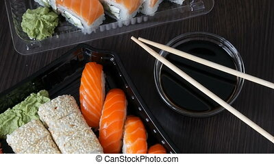 Camera zooms. Large sushi set with a variety of sushi rolls...