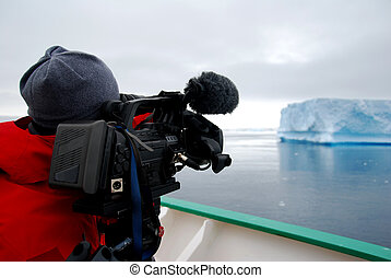 Cameraman and his camera in antarctica