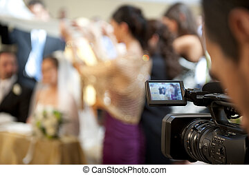 Cameraman and marriage - Cameraman recording video of a...