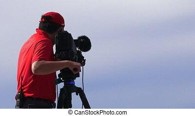 Cameraman at work - Camera operator shooting on location...