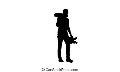 Cameraman comes with a tripod and a camera in his hands. White background. Silhouette.