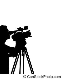 Silhouette of a cameraman filming.