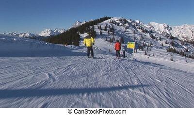 cameraman following skiers - cameraman starting slow behind...