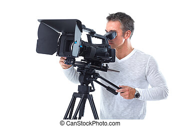 Cameraman. - Handsome man with camcorder. Isolated over...
