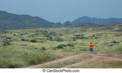 Cameraman in mountains