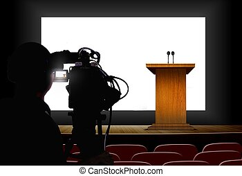 Cameraman shooting a podium with blank screen