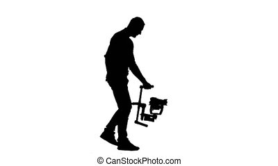 Cameraman steps with the camera on his steadicam. White background. Silhouette. Side view.