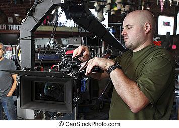 Cameraman - Crewman with digital cinema camera.