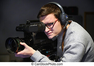 Cameraman using professional digital video camera.