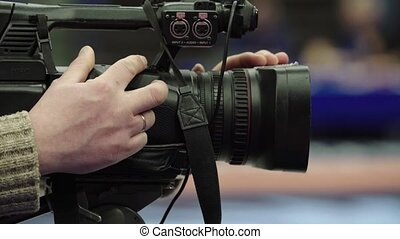 Cameraman with a camera in wrestling competitions. Close-up. Stock video footage UHD (4K) / 3840-2160 / MP4 / Codec H.264 / 25 fps.