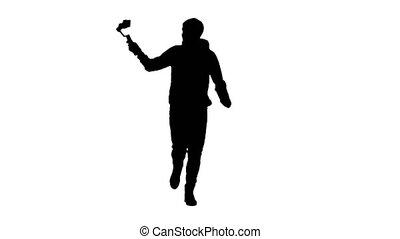 Cameraman's silhouette shooting himself while running using...