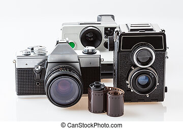 Cameras and film roll - Three vintage cameras and a roll of ...
