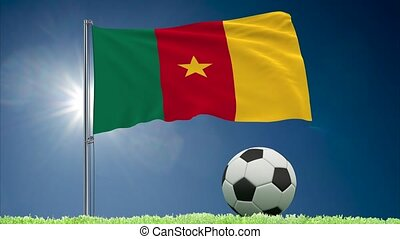 Cameroon flag fluttering and football rolls