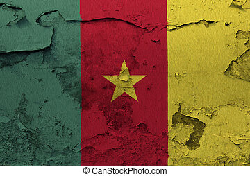 Cameroon flag painted on the cracked grunge concrete wall