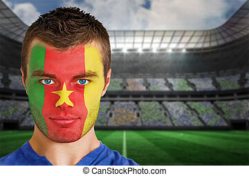 Cameroon football fan in face paint