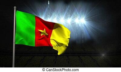 Cameroon national flag waving on flagpole on black...