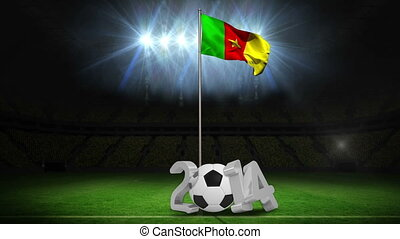 Cameroon national flag waving on pole with 2014 message on football pitch