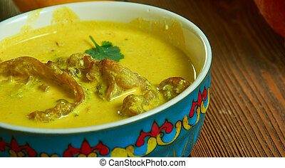 Achu soup, delicate soup prepared mostly, Cameroonian national cuisine, Traditional assorted African dishes, Top view.