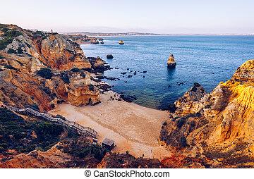 Camilo Beach (Praia do Camilo) at Algarve, Portugal with turquoise sea in background. Wooden footbridge to beach Praia do Camilo, Portugal. Wonderful view of Camilo Beach in Lagos, Algarve, Portugal.